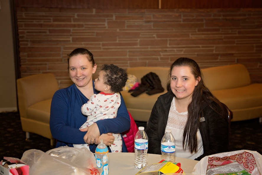 U.S. Air Force Staff Sgt. Holly Taylor, 55th Communications Squadron unit deployment manager, and her sister, Brittney Carlson, pose for a photo with Taylor's son during a Moms, Pops and Tots event on March 19. This new program is designed to bring parents with children under the age of five together so they have the opportunity to socialize and build bonds with others in the same situation. (Courtesy photo).
