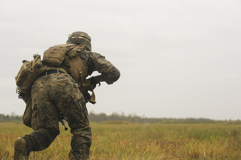 Lance Cpl. Tevin Brown, an automatic rifleman with 2nd Battalion, 8th Marine Regiment, charges toward an objective during a platoon attack training event at Camp Lejeune, N.C., April 12, 2016. The training event afforded the Marines an opportunity to develop and improve their strategies under stressful combat situations.