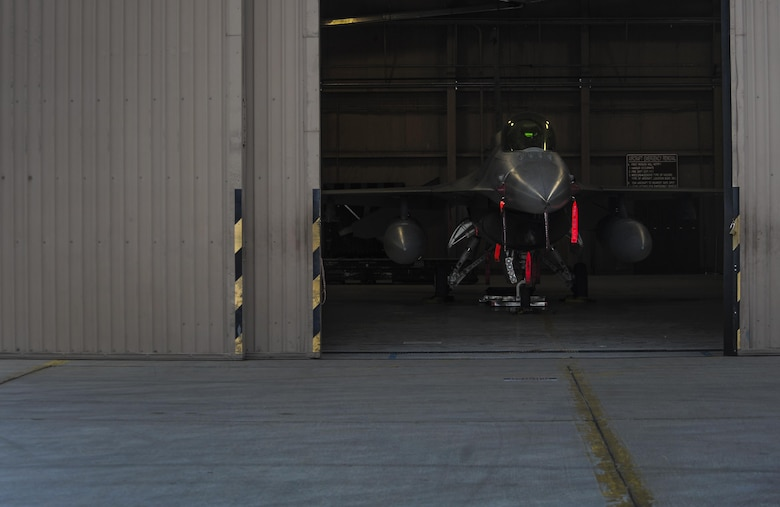 An F-16 Fighting Falcon sits in the hangar after the 57th Wings Load Crew of the Quarter Competition at Nellis Air Force Base, Nev., April 8, 2016. The load crew competition is a quarterly event held at Nellis AFB to highlight the exceptional airmen of the 57th Air Maintenance Squadron. (U.S. Air Force photo by Airman 1st Class Kevin Tanenbaum)