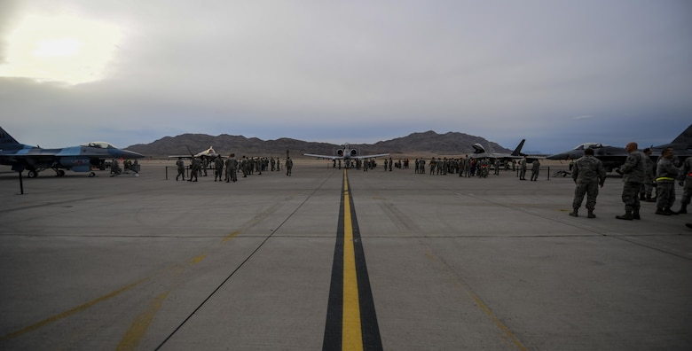 Aircraft that will be used during the 57th Wings Load Crew of the Quarter Competition sit on the flightline before the competition begins at Nellis Air Force Base, Nev., April 8, 2016. The load crews were chosen for their outstanding duty performance and exceptional loading ability for the first quarter. (U.S. Air Force photo by Airman 1st Class Kevin Tanenbaum)