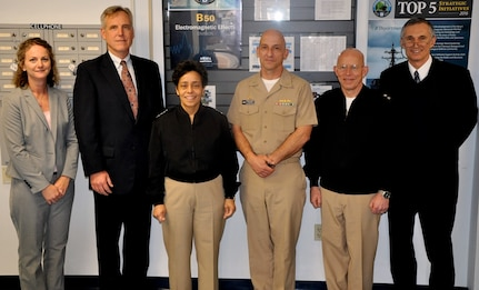 DAHLGREN, Va. (April 12, 2016) - Vice Chief of Naval Operations Adm. Michelle Howard and Naval Surface Warfare Center Dahlgren Division (NSWCDD) Capt. Brian Durant (center) take a break after meetings with senior Navy scientists and engineers.  Howard, Rear Admiral DeWolfe Miller, assistant deputy Chief of Naval Operations (OPNAV) for Warfare Systems, and Claude Barron, OPNAV Assured Command and Control director, received briefs on programs managed by three NSWCDD technical departments: Strategic & Computing Systems Department; Electromagnetic & Sensor Systems Department; and the Gun & Electric Weapon Systems Department. Standing left to right are Meredith Bondurant, NSWCDD chief of staff; Michael Till, NSWCDD acting technical director; Howard; Durant; Miller, and Barron.
