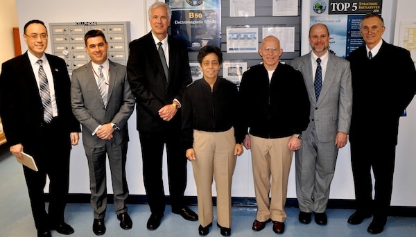 DAHLGREN, Va. (April 12, 2016) - Vice Chief of Naval Operations Adm. Michelle Howard and Rear Admiral DeWolfe Miller, assistant deputy Chief of Naval Operations (OPNAV) for Warfare Systems pause after meetings with senior Navy scientists and engineers.  Howard, Miller, and Claude Barron, OPNAV Assured Command and Control director, received briefs on programs managed by three NSWCDD technical departments: Strategic & Computing Systems Department; Electromagnetic & Sensor Systems Department; and the Gun & Electric Weapon Systems Department. Standing left to right are Jim Yee, NSWCDD acting department head for Gun & Electric Weapon Systems; Dale Sisson, NSWCDD department head for Electromagnetic & Sensor Systems; Kyle Jones, NSWCDD department head for Strategic & Computing Systems; Howard; Miller; Chris Barnes, NSWCDD division head for Electromagnetic Effects, and Barron.