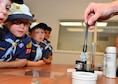Cub Scouts from Pack 388 learn different methods used to lift finger prints during a tour of the 647th SFS on Joint Base Pearl Harbor-Hickam, April 5, 2016. During the tour, members of the 647th SFS provided weapon, fingerprint and vehicle demonstration to the Cub Scouts in Den Five of Pack 388. (U.S. Air Force photo by Tech. Sgt. Aaron Oelrich/Released)