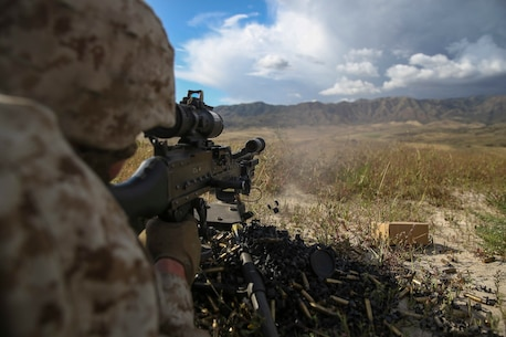 A Marine with Company K, 3rd Battalion, 1st Marine Regiment, 1st Marine Division, fires a M240 medium machine gun during live-fire machine gun target engagement training aboard Marine Corps Base Camp Pendleton, Calif., April 11, 2016. The M240 is a heavier automatic weapon than an M249 Squad Automatic Weapon and provides a higher rate of sustained fire and longer effective range. (U.S. Marine Corps photo by Lance Cpl. Timothy Valero/ Released)