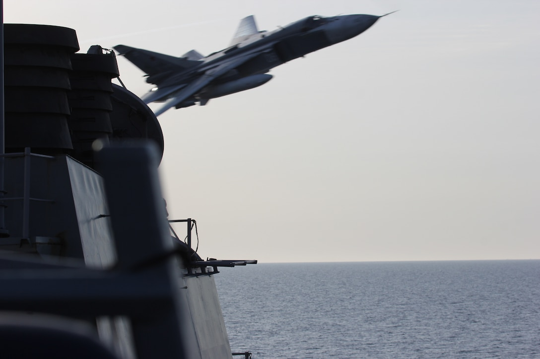 A Russian Sukhoi Su-24 attack aircraft makes a very-low-altitude pass by the USS Donald Cook in international waters in the Baltic Sea, April 12, 2016. The USS Donald Cook, a guided-missile destroyer forward-deployed to Rota, Spain, is conducting a routine patrol in the U.S. 6th Fleet area of operations in support of U.S. national security interests in Europe. Navy photo