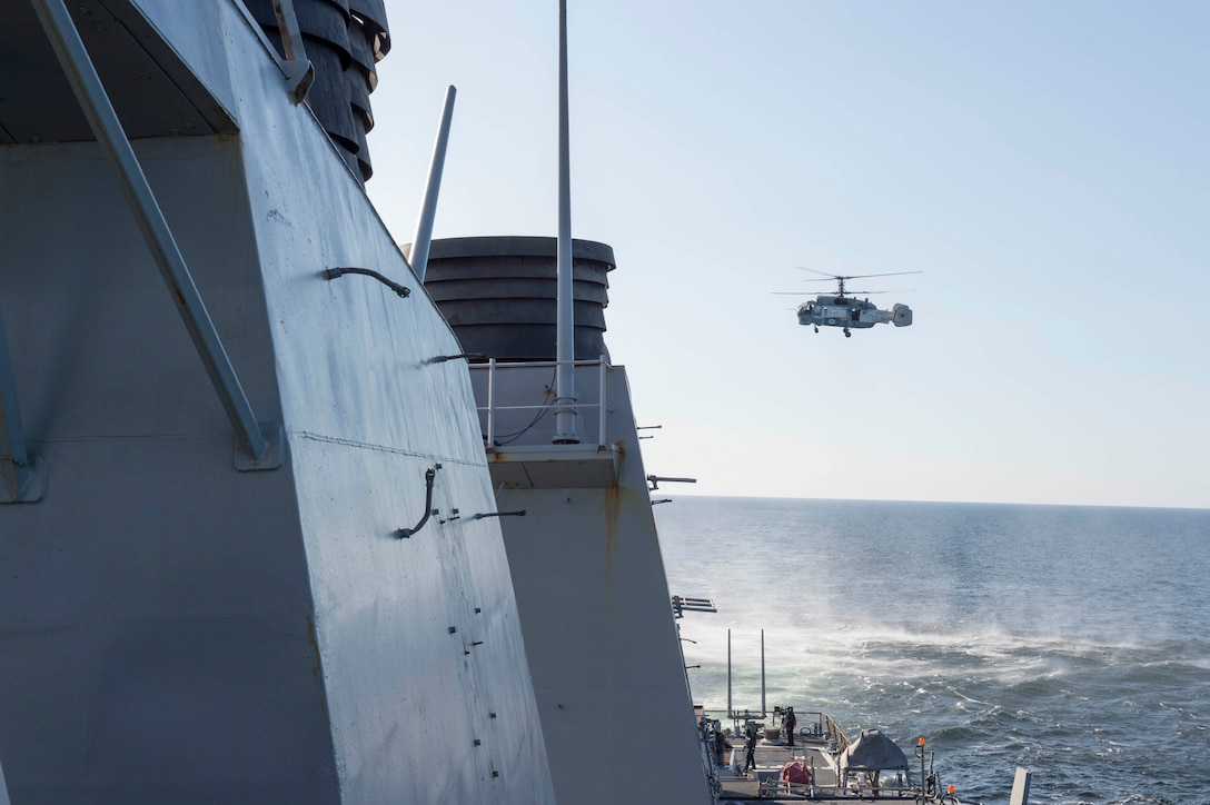 A Russian Kamov KA-27 Helix closely surveils the guided missile destroyer USS Donald Cook while the ship was operating in international waters in the Baltic Sea, April 12, 2016. The USS Donald Cook is forward-deployed to Rota, Spain, and is conducting routine patrols in the U.S. 6th Fleet area of operations in support of U.S. national security interests in Europe. Navy photo