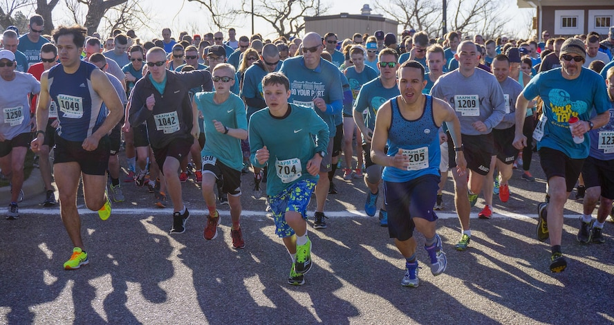 Participants take off from the starting line of the Sexual Assault Awareness 5-kilometer run April 9, 2016, in Lion's Park, Cheyenne, Wyo. More than 500 participants – including Airmen, Soldiers, Guardsmen and community members – ran, walked and ruck-marched the course. (U.S. Air Force photo by Senior Airman Brandon Valle)