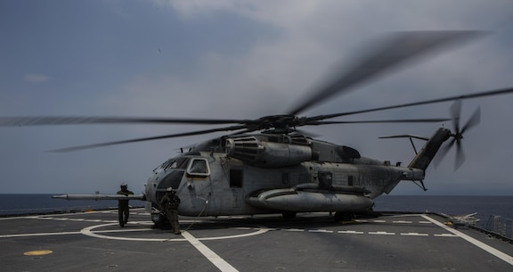 A U.S. Marine Corps CH-53E Super Stallion helicopter, lands on the joint high speed vessel, the U.S.N.S. Millinocket during Balikatan 16, off the coast of Panay, Philippines, April 12, 2016. After landing on deck, infantry units with 2nd Battalion, 2nd Marine Regiment de-boarded the helicopter marking the completion phase of an aerial assault of Antique Airfield. Marines and Navy work together to increase our amphibious capabilities to be able to work effectively to provide relief and assistance in the event of natural disasters and other crises that threaten public safety and health across the Indo-Asia-Pacific region. (U.S. Marine Corps photo by Lance Cpl. Jessica N. Etheridge/released)