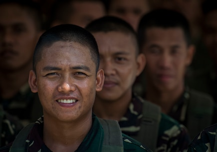 "Philippine Air Force members stand at attention before the Capas Freedom March during Balikatan 16 at Capas, Philippines, April 11, 2016. U.S. and Philippine service members participated in the public event which follows the path in honor of those U.S. and Philippine service members who suffered the Bataan Death March during the Second World War. This year marks the 32nd iteration of Balikatan where U.S. service members continue to work ""shoulder-to-shoulder"" with members of the Armed Forces of the Philippines to increase combined readiness to crises and conflict across the Indo-Asia-Pacific region."