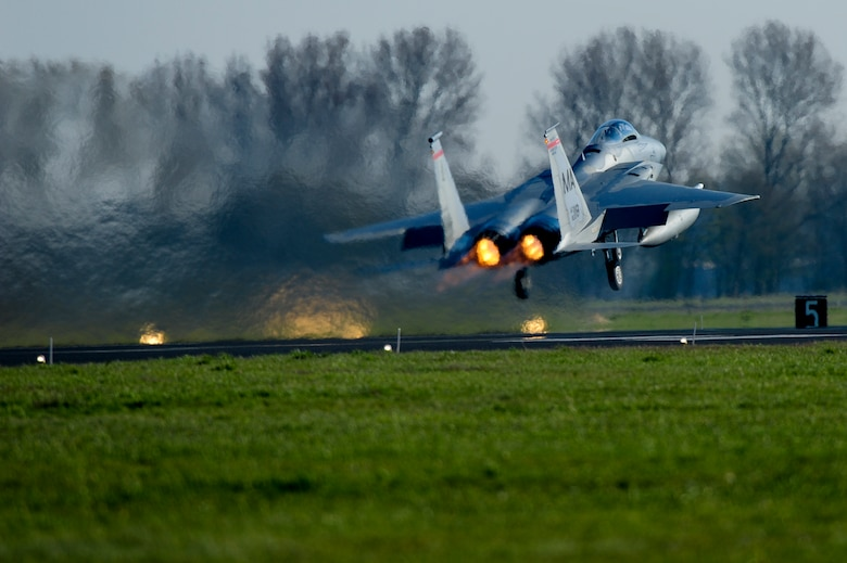 A U.S. Air Force F-15C Eagle fighter aircraft assigned to the 131st Expeditionary Fighter Squadron takes off during a theater security package deployment at Leeuwarden Air Base, Netherlands, April 11, 2016. The F-15s represented a theater security package rotation, which began in the European theater in 2015 to reassure NATO allies and partner nations of the U.S. commitment to the security and stability of Europe. (U.S. Air Force photo by Staff Sgt. Joe W. McFadden/Released)