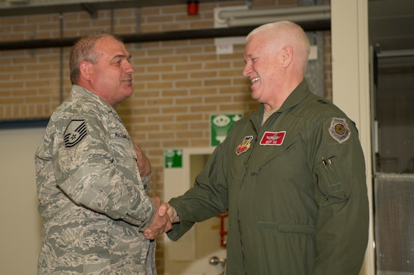 U.S. Air Force Maj. Gen. Scott Rice, Massachusetts National Guard adjutant general, right, shakes the hand of U.S. Air Force and Massachusetts Air National Guard Master Sgt. Donald Masciadrelli, a 104th Maintenance Squadron avionics technician and Montgomery, Mass., native, during a theater security package deployment at Leeuwarden Air Base, Netherlands, April 12, 2016. Rice coined Masciadrelli for excellence as part of his deployment in support of Operation Atlantic Resolve. (U.S. Air Force photo by Staff Sgt. Joe W. McFadden/Released)