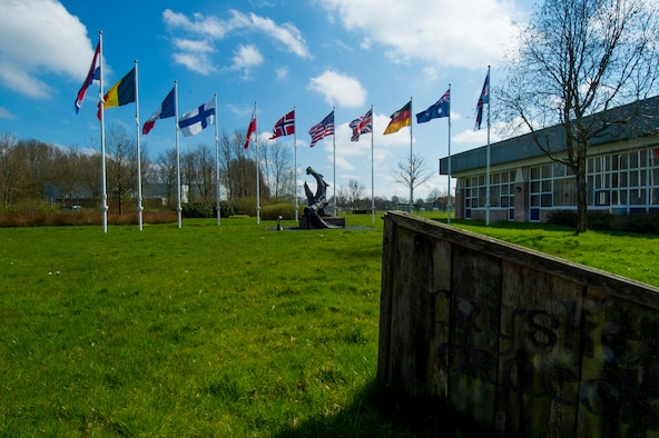 The flags of the national partners of Frisian Flag 2016 remain on display outside of the Frisian Dragon dining facility at Leeuwarden Air Base, Netherlands, April 12, 2016. More than 70 aircraft and personnel from the United States, Netherlands, Belgium, France, Finland, Poland, Norway, United Kingdom, Germany and Australia will participate in Frisian Flag 2016 at Leeuwarden April 11-22, 2016, with as many as 50 executing flight operations each day. (U.S. Air Force photo by Staff Sgt. Joe W. McFadden/Released)