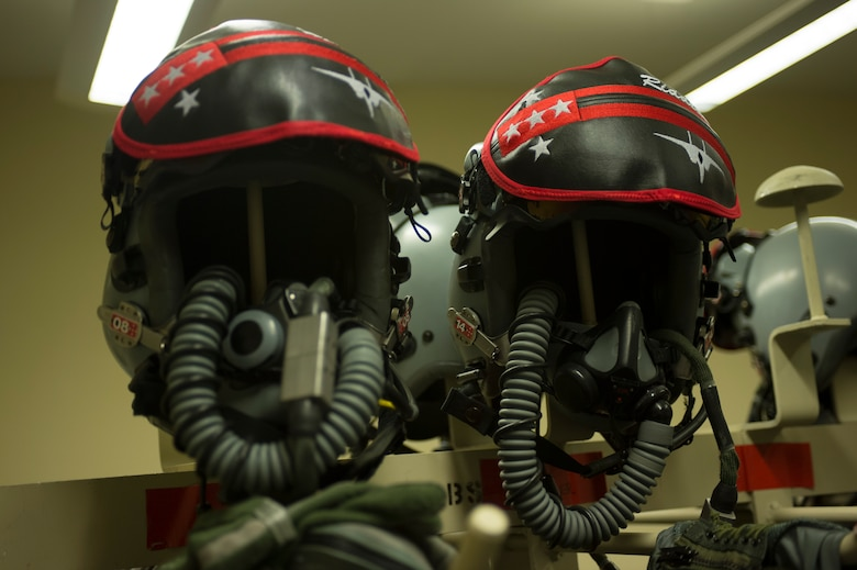 Two helmets belonging to 131st Expeditionary Fighter Squadron F-15C Eagle fighter aircraft pilots rest on posts inside an aircrew flight equipment room during a theater security package deployment at Leeuwarden Air Base, Netherlands, April 11, 2016. The 131th EFS deployed to Europe to strengthen interoperability between NATO allies and to demonstrate U.S. commitment to the security and stability of Europe. (U.S. Air Force photo by Staff Sgt. Joe W. McFadden/Released)