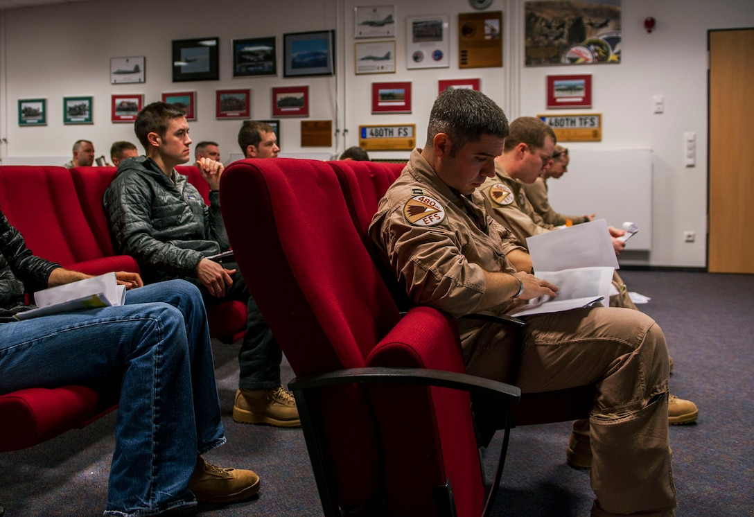 Pilots from the 480th Fighter Squadron attend a briefing in the squadron's conference room before their deployment at Spangdahlem Air Base, Germany, April 7, 2016. The 480th FS deployed to Southwest Asia in support of Operation Inherent Resolve. (U.S. Air Force photo by Airman 1st Class Timothy Kim/Released)