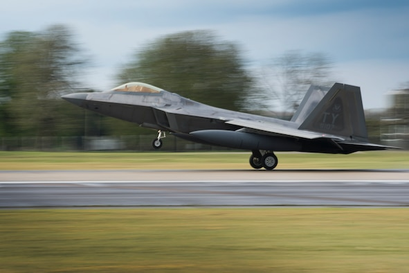 An F-22 Raptor from the 95th Fighter Squadron lands at Royal Air Force Lakenheath, England, April 12, 2016. The aircraft arrival marks the second time the U.S. European Command has hosted a deployment of F-22 aircraft in the EUCOM Area of Responsibility. (U.S. Air Force photo/Airman 1st Class Erin R. Babis)