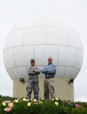 Lt. Col. Jim Horne, 30th Range Maintenance Squadron commander, stands with Bill Prenot, 30th Space Wing director of plans and programs, at a Command Transmitter site, April 12, 2016, Vandenberg Air Force Base, Calif. Prenot was the first commander for the 30th RMS taking command in mid-2003. (U.S. Air Force photo by Senior Airman Ian Dudley/Released)