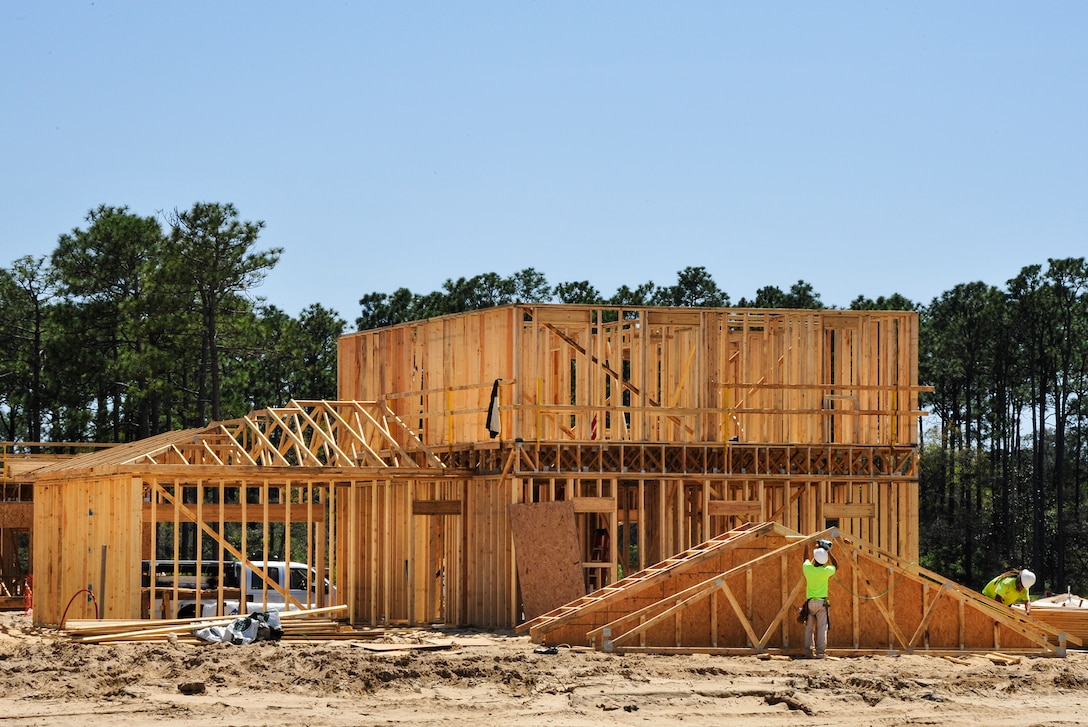 """Construction workers make progress on one of the 747 privatized homes being built on Eglin Air Force Base, Fla., April 7. The new development will include multiple playgrounds, a dog-friendly """"bark"""" park, a community center with a fitness room, and a pool. The entire community is estimated to be completed by 2019. (U.S. Air Force Photo/Jasmine Porterfield)"""
