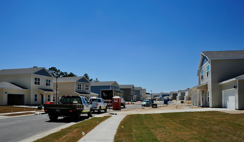 """Construction workers complete several of the 747 privatized homes being built on Eglin Air Force Base, Fla., April 7. The new development will include multiple playgrounds, a dog-friendly """"bark"""" park, a community center with a fitness room, and a pool. The entire community is estimated to be completed by 2019. (U.S. Air Force Photo/Jasmine Porterfield)"""