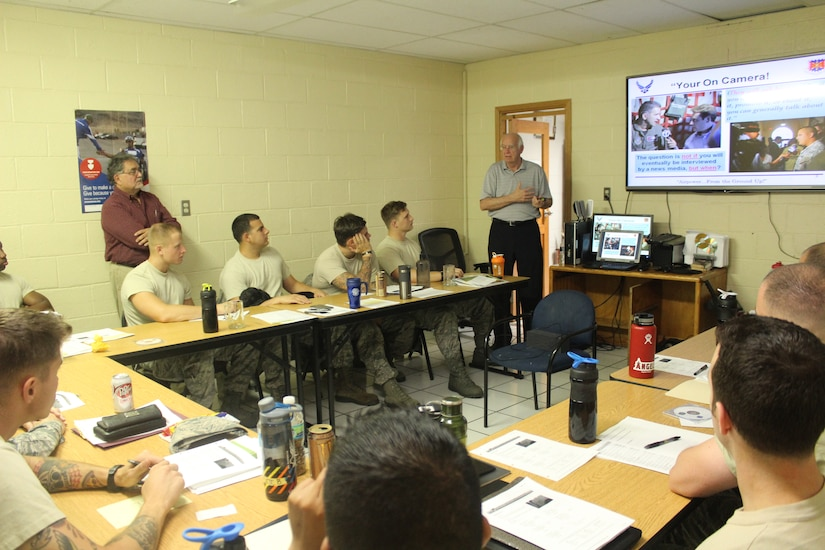 Firefighters from the 612th Air Base Squadron listen as instructor Joe Allred (far right), United States Air Force Expeditionary Center instructor, teaches a class on Public Affairs during an Air Advisor course as part of the preparations for the Central America Sharing Mutual Operational Knowledge and Experiences exercise at Soto Cano Air Base, Honduras, April 1, 2016. The training lasted a week and involved diverse lessons including Mesoamerican Religions, Foreign Disclosure, and Cross Cultural Communications & Negotiations. (U.S. Army photo by Maria Pinel/Released)