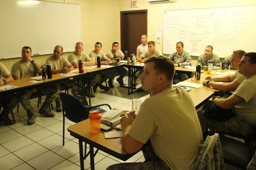 Firefighters from the 612th Air Base Squadron sit through a Public Affairs class at Soto Cano Air Base, Honduras, April 1, 2016. The class was part of an Air Advisor course taught as part of the previous preparations to the Central America Sharing Mutual Operational Knowledge and Experiences exercise that is hosted by Joint Task Force-Bravo involving firefighters from all across Central America. (U.S. Army photo by Maria Pinel/Released)