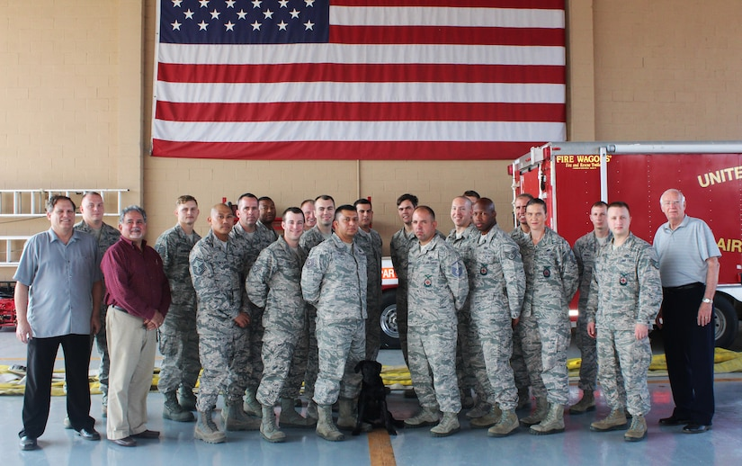 Servicemembers from the 612th Air Base Squadron Fire Department pose for a group photo after completing an Air Advisor course taught by Mr. Greg Kruse (far left), Mr. Dave Enriquez (left), and Mr. Joe Allred (far right), United States Air Force Expeditionary Center instructors April 1, 2016, at Soto Cano Air Base, Honduras. The course included diverse lessons such as Mesoamerican Religions, Foreign Disclosure, Cross Cultural Communications & Negotiations, and Public Affairs, as part of previous preparation to the Central America Sharing Mutual Operational Knowledge and Experiences exercise hosted by Joint Task Force-Bravo that involves firefighters from all across Central America. (U.S. Army photo by Maria Pinel/Released)