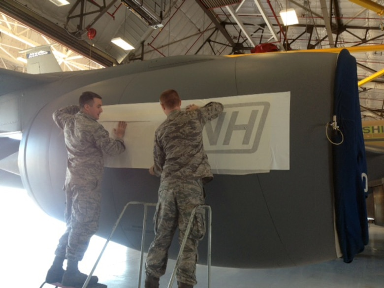 U.S. Air Force Airman 1st Class Chris Gaudet and Staff Sgt. Andrew Morrison, 157th Maintenance Group aircraft structural maintenance specialists stencil the number four engine cowling on KC-135R 57-1430, Pease Air National Guard Base, N.H., Oct. 6, 2015. (U.S. Air National Guard photo)