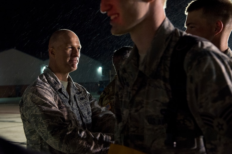 Col. Tim Donnellan, the 124th Fighter Wing commander, shakes hands with Airmen from the 124th Fighter Wing as they board an aircraft April 12, 2016. More than 12 civic and military leaders greeted and shook the hands of the Airmen deploying in support of the U.S.-led fight Operation Inherent Resolve. (U.S. Air National Guard photo by Tech. Sgt. Joshua Allmaras/Released)