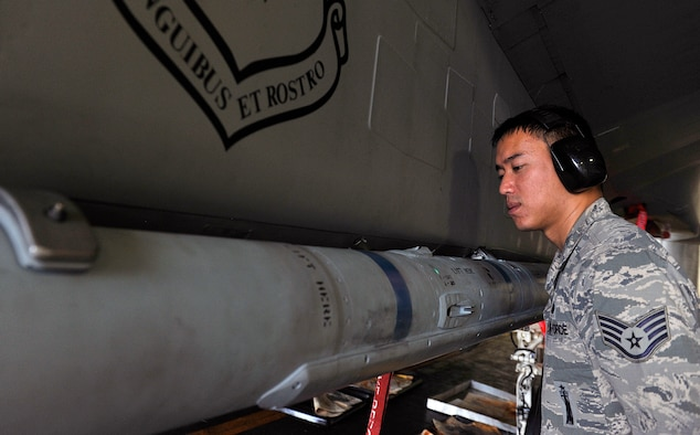 U.S. Air Force Staff Sgt. Paolo Santos, 18th Maintenance Group loading standardization crew, inspects an AIM-120 advanced medium-range air-to-air missile during weapons load training April 13, 2016, at Kadena Air Base, Japan. The 18th Maintenance Group prepares each aircraft for flight to ensure safety and reliability in support of the training mission here at Kadena. (U.S. Air Force photo by Naoto Anazawa)