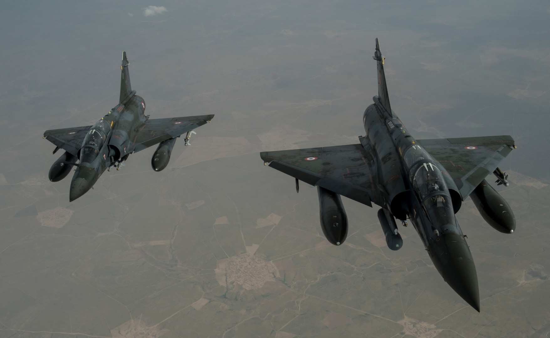 Two French Mirage 2000Ds fly over Iraq in support of Operation Inherent Resolve April 8, 2016. A coalition of regional and international nations have joined together to defeat ISIL and the threat they pose to Iraq, Syria, the region and the wider international community. (U.S. Air Force photo by Staff Sgt. Corey Hook)