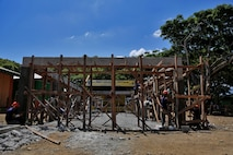 "Philippine Navy Seabees and U.S. Soldiers with 130th Engineering Brigade, build a multipurpose facility in Matahimik-Bucana elementary school in Puerto Princesa, Philippines during exercise Balikatan April 8, 2016.  Balikatan, which means ""shoulder to shoulder"" in Filipino, is an annual bilateral training exercise focused on improving the ability of Philippine and U.S. military forces to work together during planning, contingency and humanitarian assistance and disaster relief operations."