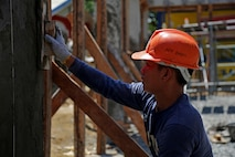 "Philippine Navy Apprentice Fireman Johnar Bayas build a multipurpose facility in Matahimik-Bucana elementary school in Puerto Princesa, Philippines during exercise Balikatan April 8, 2016.  Balikatan, which means ""shoulder to shoulder"" in Filipino, is an annual bilateral training exercise focused on improving the ability of Philippine and U.S. military forces to work together during planning, contingency and humanitarian assistance and disaster relief operations."