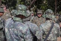 U.S. Marine Corps Sgt. Maj. Vincent C. Santiago, sergeant major for 3d Marine Division speaks with the Filipino Marines of 4th Marine Brigade during Balikatan 2016 (BK 16) on April 9, 2016.  The purpose of BK 16 is to strengthen interoperability and partner-nation capabilities for the planning and execution of military operations, and advance regional security operations.