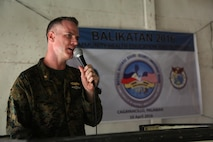 """U.S. Navy Lt. Cmdr. Lt. Cmdr. Michael S. Jette, community health engagment officer in charge for exercise Balikatan, says his remarks during the closing ceremony after conducting a cooperative health engagement with the Armed Forces of the Philippines and Austrailian Defense Force during exercise Balikatan in Cagayancillo, Philippines April 10, 2016.  Balikatan, which means """"shoulder to shoulder"""" in Filipino, is an annual bilateral training exercise focused on improving the ability of Philippine and U.S. military forces to work together during planning, contingency and humanitarian assistance and disaster relief operations."""