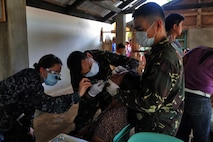 "U.S. Navy Lt. Kerry Baymann, a dentist on the USS Theodore Roosevelt (CVN 71), assists Armed Forces of the Philippines dentists during a cooperative health engagement during exercise Balikatan in Cagayancillo, Philippines April 10, 2016.  Balikatan, which means ""shoulder to shoulder"" in Filipino, is an annual bilateral training exercise focused on improving the ability of Philippine and U.S. military forces to work together during planning, contingency and humanitarian assistance and disaster relief operations."
