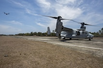 U.S. MV-22 Ospreys land on Antique Airfield during a simulated airfield insert U.S. Marines with 2d Battalion, 2d Marine Regiment, Golf Company, walk to the Entry Control Command while executing a simulated airfield insert during Balikatan 2016 (BK 16) on April 11, 2016.  The purpose of BK 16 is to strengthen interoperability and partner-nation capabilities for the planning and execution of military operations, and advance regional security operations.