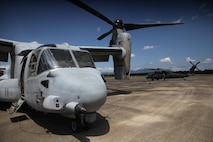 A U.S. Marine MV-22B Osprey refuels A U.S. Army UH-60 Black Hawk at an aerial delivery ground refueling station during Balikatan 16, in San Fernando, Philippines, April 12, 2016. The Osprey is assigned to Marine Medium Tilt-rotor Squadron 262, Marine Aircraft Group 36, 1st Marine Aircraft Wing, III Marine Expeditionary Force, while the Black Hawk is from Bravo 3-25, Aviation Regiment. After establishing the ADGR, the Marines of VMM-262 refueled multiple U.S. Army aircrafts from Bravo 3-25, Aviation Regiment via the MV-22B Osprey.