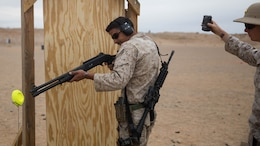 Cpl. Anthony Lubbers, designated marksmanship instructor, Combat Center Marksmanship Training Unit, prepares to breach a door during the Western Regional Combat Match at Marine Corps Air Combat Center, April 8, 2016.