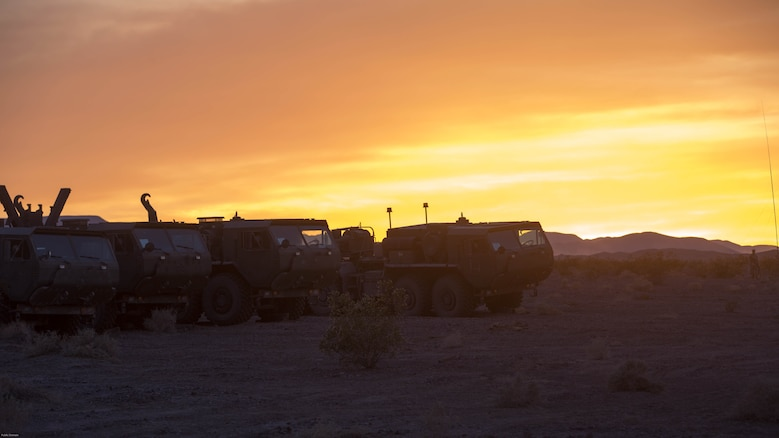 Logistics Vehicle System Replacements with Combat Logistics Battalion 7, prepare to move equipment at the Lead Mountain training area during 7th Marine Regiment's Combined Arms Live Fire Exercise at Marine Corps Air Ground Combat Center, April 5, 2016. CALFEX served as the kinetic portion of Desert Scimitar 16, an annual 1st Marine Division training evolution.