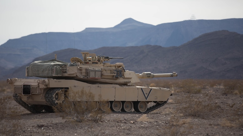 An M1A1 Abrams Main Battle Tank with Company B, 1st Tank Battalion, prepares to move toward its objective in the Blacktop training area during 7th Marine Regiment's Combined Arms Live Fire Exercise at marine Corps Air Ground Combat Center April 6, 2016. CALFEX served as the kinetic portion of Desert Scimitar 16, an annual 1st Marine Division training evolution.