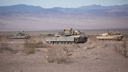 M1A1 Abrams Main Battle Tanks with Company B, 1st Tank Battalion, stage in the Blacktop training area during 7th Marine Regiment's Combined Arms Live Fire Exercise at Marine Corps Air Ground Combat Center April 6, 2016. CALFEX served as the kinetic portion of Desert Scimitar 16, an annual 1st Marine Division training evolution.