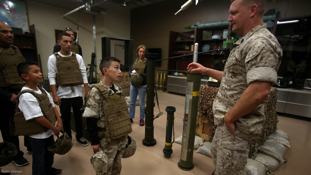 Nathan Aldaco, a 12 year-old boy with hypoplastic left heart syndrome, learns about explosive ordnance during a Make-A-Wish event supported by 7th Engineer Support Battalion, 1st Marine Logistics Group, at Marine Corps Base Camp Pendleton, California, March 24, 2016. Marines with 7th ESB and Explosive Ordnance Disposal helped to make Nathan's wish of training with Marines come true by demonstrating the capabilities of their EOD robots and detonating TNT, C4, dynamite and blasting caps, while the heavy equipment operators gave him the opportunity to ride the D7 dozer and the excavator, in which he dug a pit, built a berm, and broke several large tree trunks.