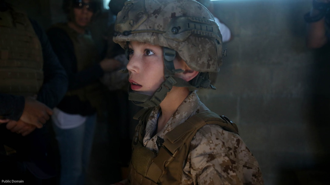 Nathan Aldaco, a 12 year-old boy with hypoplastic left heart syndrome, gets a safety brief before watching explosives detonate during a Make-A-Wish event supported by 7th Engineer Support Battalion, 1st Marine Logistics Group, at Marine Corps base Camp Pendleton, California, March 24, 2016. Marines with 7th ESB and Explosive Ordnance Disposal helped to make Nathan's wish of training with Marines come true by demonstrating the capabilities of their EOD robots and detonating TNT, C4, dynamite and blasting caps, while the heavy equipment operators gave him the opportunity to ride the D7 dozer and the excavator, in which he dug a pit, built a berm, and broke several large tree trunks.