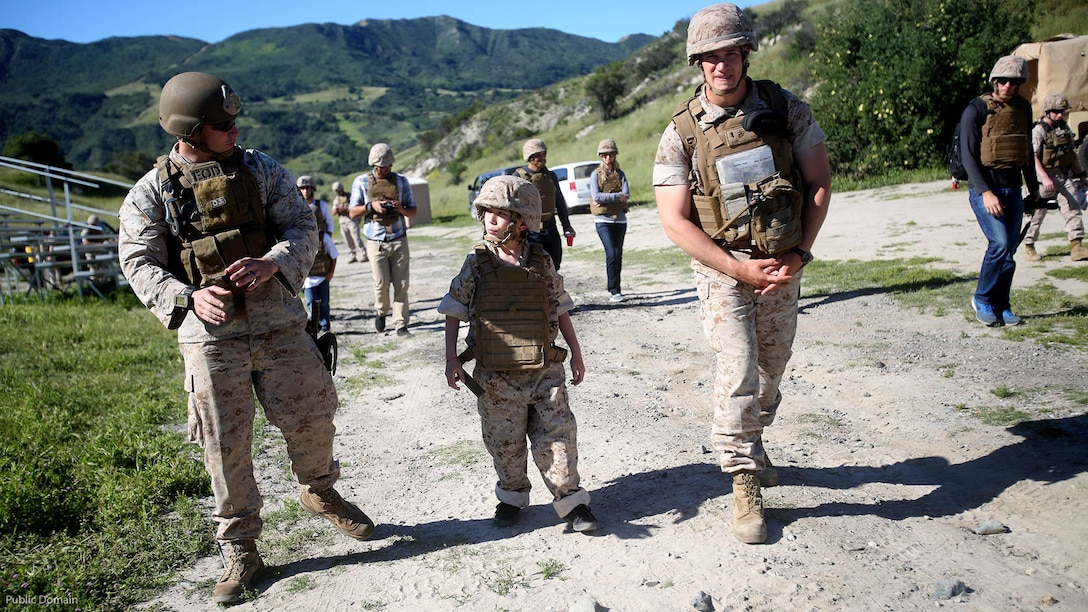 Nathan Aldaco, a 12 year-old boy with hypoplastic left heart syndrome, walks with Marines to a demolition site during a Make-A-Wish event supported by 7th Engineer Support Battalion, 1st Marine Logistics Group, at Marine Corps Base Camp Pendleton, California, March 24, 2016. The Marines helped to make Nathan's wish of training with Marines come true by demonstrating the capabilities of their EOD robots and detonating TNT, C4, dynamite and blasting caps.