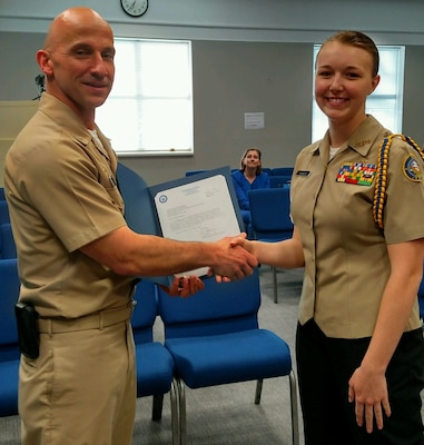 King George High School Naval Junior Reserve Officer Training Corps (NJROTC) cadet Madeline Hassler receives a letter of appreciation and a John Dahlgren 200th Birthday coin from Naval Surface Warfare Center Dahlgren Division (NSWCDD) Commanding Officer Capt. Brian Durant at the King George County School Board Meeting, April 11.