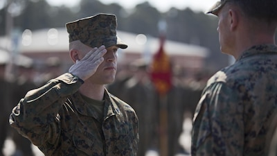 Marine Corps Cpl. Joseph Currey, left, salutes Lt. Col. Jeremy Winters, right, during an award ceremony at Marine Corps Air Station Cherry Point, N.C., March 1, 2016. Currey was awarded the Navy and Marine Corps Commendation Medal for his actions after witnessing an ambulance wreck. Marine Corps photo by Lance Cpl. Austin Lewis
