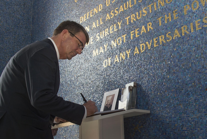 Defense Secretary Ash Carter signs a guest book at the Manila American Cemetery in Manila, Philippines, April 14, 2016, after laying a wreath to honor U.S. service members. DoD photo by Air Force Senior Master Sgt. Adrian Cadiz