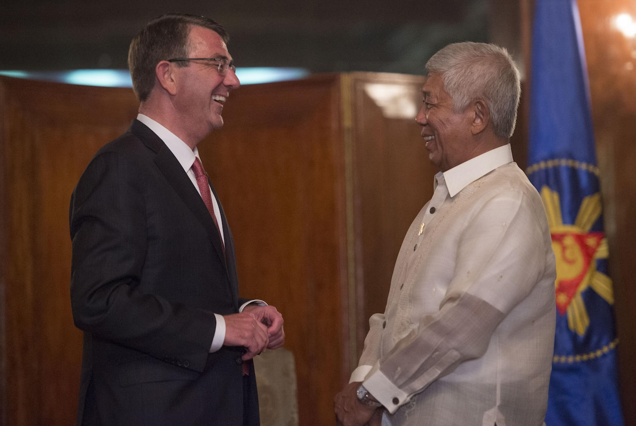Defense Secretary Ash Carter shares a light moment with Philippine Defense Secretary Voltaire Gazmin as they meet to discuss matters of mutual importance at the Malacanang Palace in Manila, Philippines, April 14, 2016. DoD photo by Air Force Senior Master Sgt. Adrian Cadiz