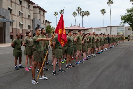 Marines with the 11th Marine Expeditionary Unit, I Marine Expeditionary Force, stand in preparation for a motivational run at Marine Corps Base Camp Pendleton, California, April 7, 2016., The run was conducted in honor of the 11th MEU's composition ceremony. The ceremony officially recognized the merging of the Battalion Landing Team, 1st Bn, 4th Marines; Marine Medium Tiltrotor Squadron 163 (Reinforced); and Combat Logistics Bn 11, into the MEU. The run was led by Clay Tipton, commanding officer of the 11th MEU, and Sgt. Maj. Keith Massi, sergeant major of the 11th MEU. (U.S. Marine Corps photo by Cpl. April L. Price/Released)