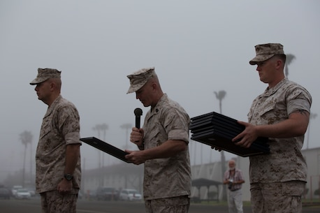MARINE CORPS BASE CAMP PENDLETON, Calif. – Lieutenant General David Berger, I Marine Expeditionary Force commanding general, and Sgt. Maj. Bradley Kasal, I MEF Sergeant Major, present meritorious promotion certificates to Marines from across Camp Pendleton during a meritorious promotion ceremony April 4, 2016. Meritorious promotions are a way for the Marine Corps to reward outstanding performance and highlight the dedication and spirit among those who serve within it. (Marine Corps photo by Cpl. Jonathan Boynes/ Not Released)