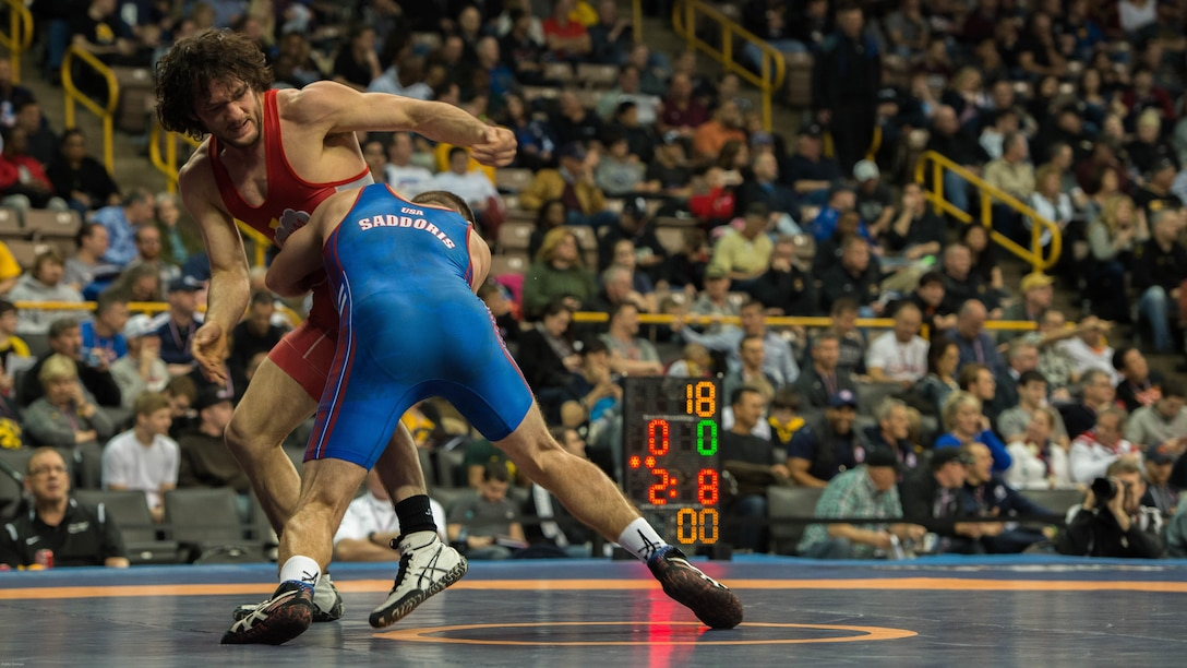 Capt. Bryce Saddoris, captain of the All-Marine Wrestling team, attempts a take down during a match at the 2016 U.S. Olympic Wrestling Trials in Iowa City, Iowa April 9, 2016. Saddoris competed in the 145-pound weight class and was one of four representing the Marine Corps at the event.
